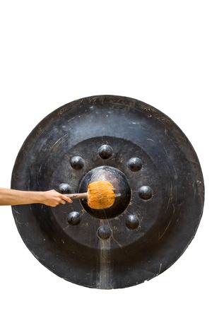Beating gongs