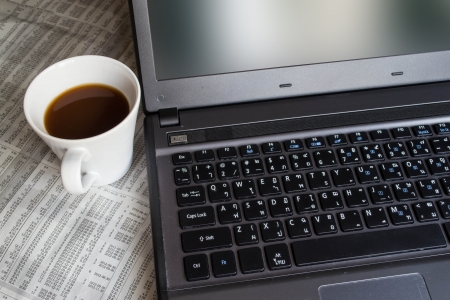 Notebook computer and coffee cup photo