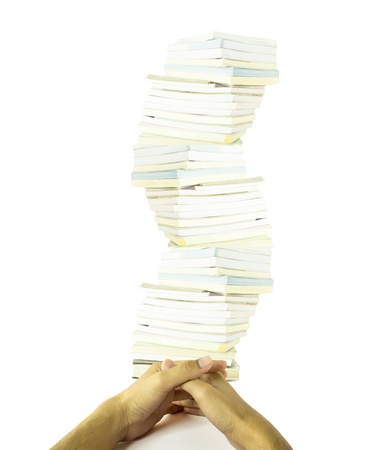 Hand and a pile of books
