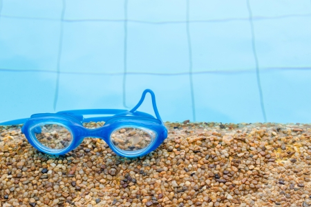 Swimming Goggle on the edge of the pool Stock Photo