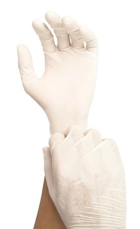utiles de aseo personal: poner los guantes en aislar el fondo blanco