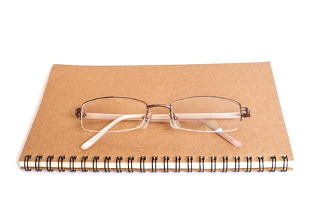 glasses and notebook on isolate white background