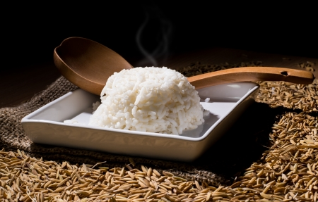 rice on bag and paddy