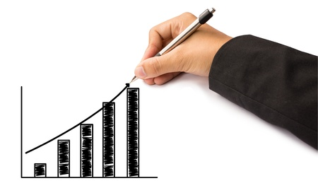 hand of business writing graph photo