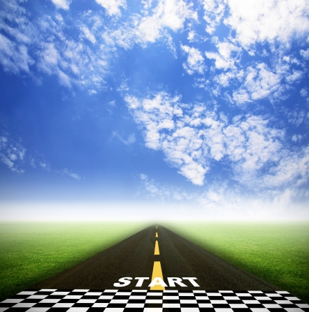 road and starting point on grass field with sky
