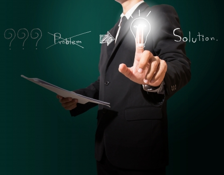 business man writing solution concept