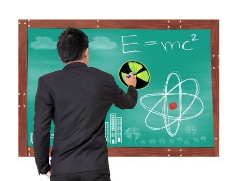 theory of relativity: man drawing equation and scintilla concept Stock Photo