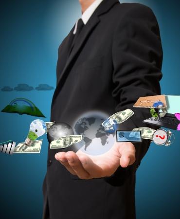 businessman holding many things Standard-Bild