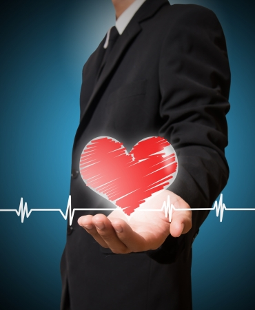 businessman holding heart and chart heartbeat