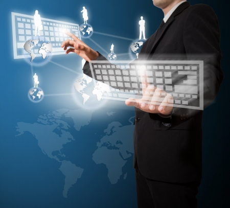 businessman touch keyboard and connection of business Stock Photo