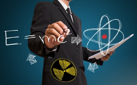 man drawing equation and scintilla concept Stock Photo