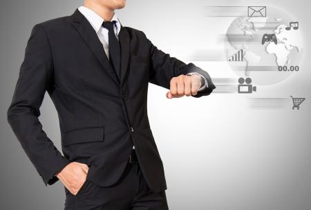 businessman look digital wristwatch in future,wristwatch hi technology