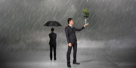 businessman hold dollar tree on raining by different photo