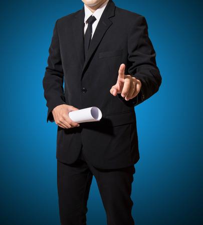 Geschäftsmann Touch auf farbigem Hintergrund Standard-Bild - 27357104