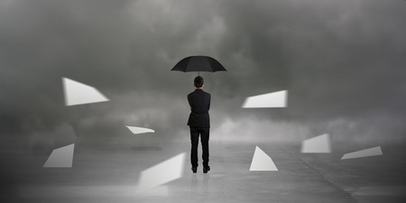 businessman standing in the Monsoon Standard-Bild