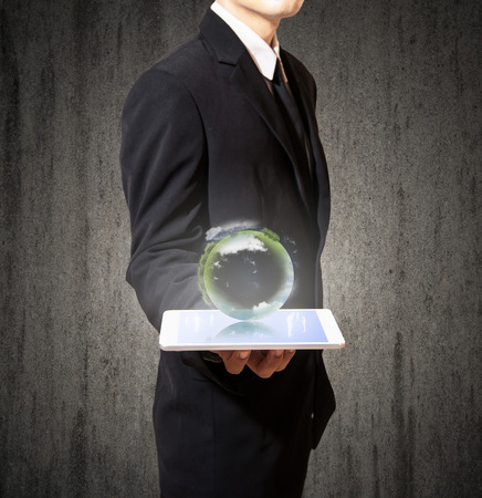 businessman with planet on tablet