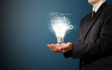 businessman hold lamp of idea Standard-Bild