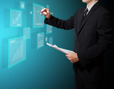 businessman analysis graph on screen high technology