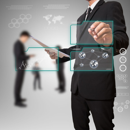 businessman pointing on screen,in screen for text or image Standard-Bild