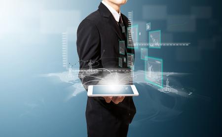 Geschäftsmann mit Tablet-und High-Tech Standard-Bild - 27357220