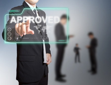 businessman touch on high technology screen for approved photo