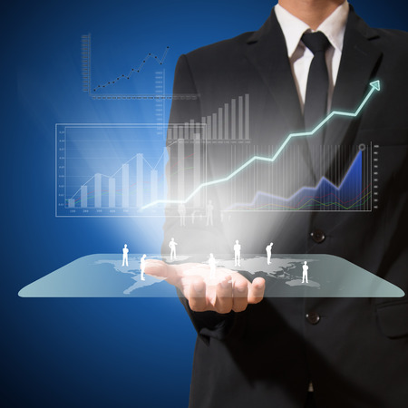 businessman analyze graph with technology on hand and connection of business