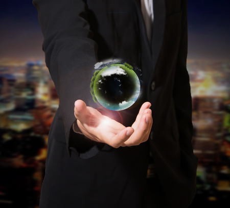 businessman with planet in hand