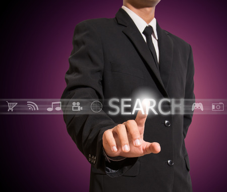 business man touch search Standard-Bild