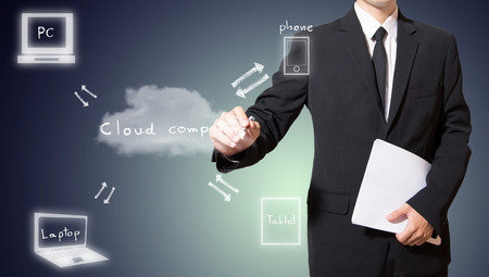 Businessman drawing cloud computing concept photo