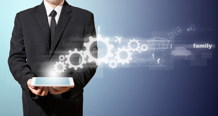 businessman hold tablet with idea Standard-Bild