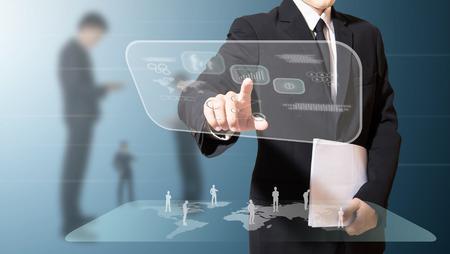 businessman touching high technology screen Standard-Bild