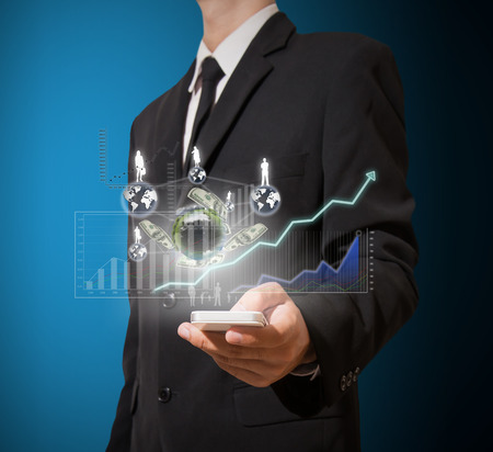 businessman analyze graph and finance on mobile phone