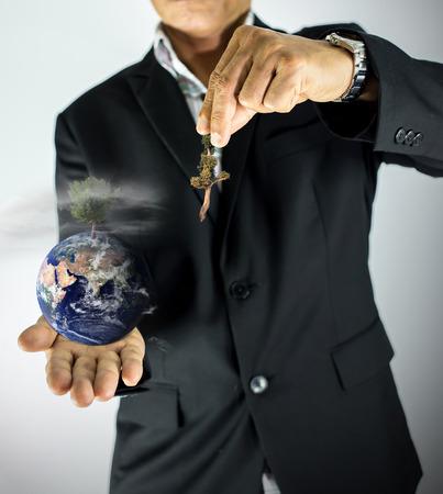 businessman %u0E49hold  the earth and plant tree