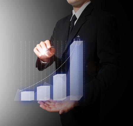 Geschäftsmann analysieren Graph Standard-Bild - 27357325