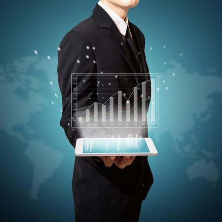 businessman holding digital graph improve suggest more on tablet Standard-Bild