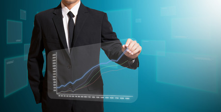 businessman analysis graph on screen high technology