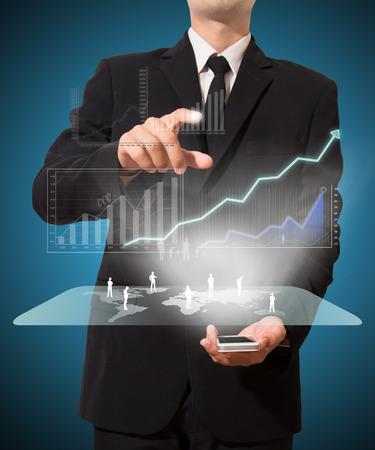 businessman analyze graph with technology on mobile Standard-Bild
