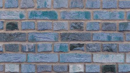 Light blue / turquoise clinker bricks from a wall, brick facade, texture wallpaper