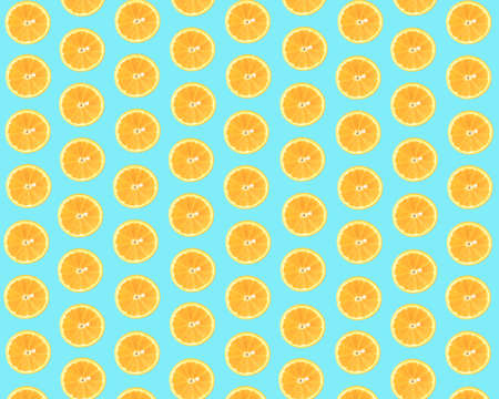 Minimal summer pattern made of orange on a light blue cyan background