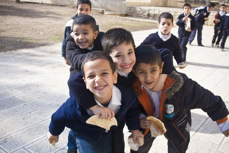 Muslim children from a closed school on the Temple Mount in Jerusalem are happy to get photographed during their class break.Strangers are not allowed in the area except for several hours a day, thus the mere fact of interacting with a stranger is an outs Stock Photo - 10006017
