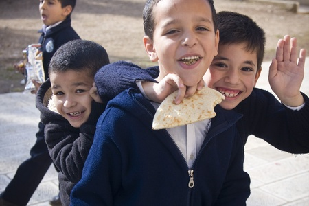 Muslim children from a closed school on the Temple Mount in Jerusalem are happy to get photographed during their lunch break.Strangers are not allowed in the area except for several hours a day, thus the mere fact of interacting with a stranger is an outs Stock Photo - 10006014
