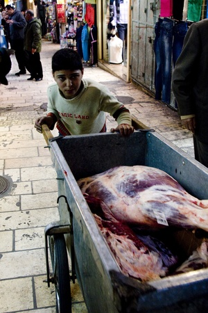 A young Arabian boy working in the market place in the old city of Jerusalem. Stock Photo - 10006028