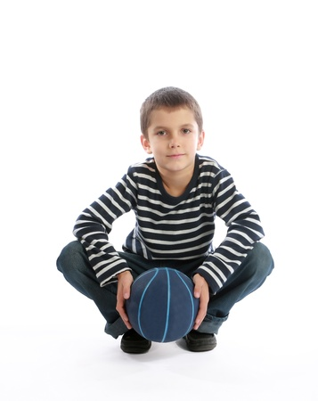Teenage boy holding a basketball ball in his hands (isolated on whiite background)