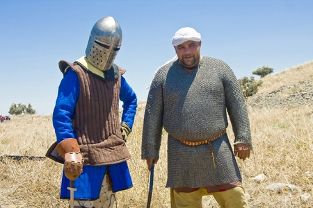 sword act: Two man clad as a Saracene and a Knight posing before the event of historical reenactment on the historical location of the Battle of Hattin in Israel. Historical reenactment is a popular hobby for history lovers worldwide. The Battle of Hattin (Qarne Hit Editorial