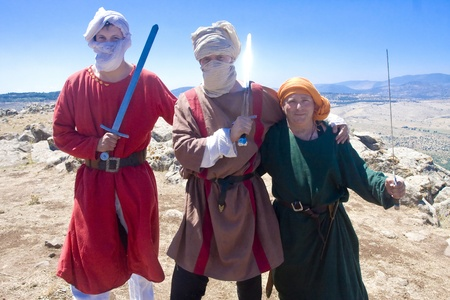 Three men clad as Saracenes during the event of historical reenactment on the historical location of the Battle of Hattin in Israel. Historical reenactment is a popular hobby for history lovers worldwide. The Battle of Hattin (Qarne Hittim) was a crucial