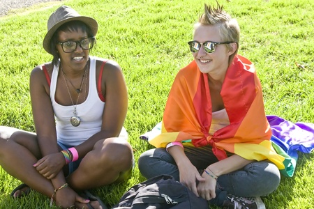 Jerusalem, Israel - July 28, 2011 - Two young female participants of the Gay Pride Parade in Jerusalem, Israel, resting on the greens during the preparations for the march. Stock Photo - 10274111