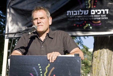 knesset: Jerusalem, Israel - July 28, 2011 - Israeli Knesset Member Nitzan Horowitz speaking before the participants of the Pride Parade in Jerusalem, Israel, during the preparations for the march on July 28, 2011. Editorial