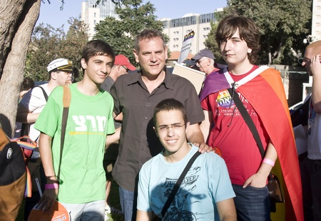 knesset: Jerusalem, Israel - July 28, 2011 - Young participants of the Gay Pride and Social Liberty March in Jerusalem, Israel are taking photo with the Knesset member Nitzan Horowitz before the march.