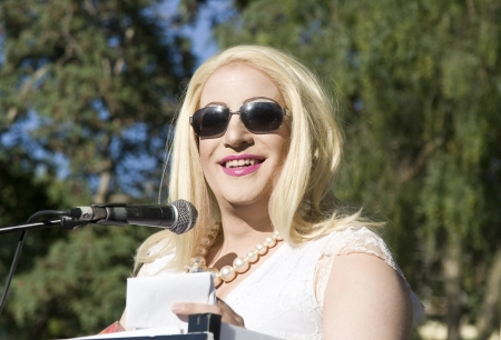 Jerusalem, Israel - July 28, 2011 - Female transgender speaking from the stand during the preparations for the Gay Pride and Social Liberty Parade in Jerusalem, Israel. Editorial