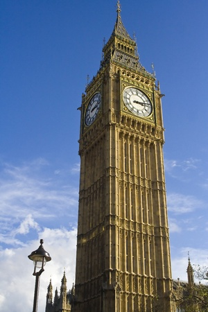 The famous Big Ben Tower, the main and most famous landmark of London, UK, against blue sky on a sunny day. Stock Photo